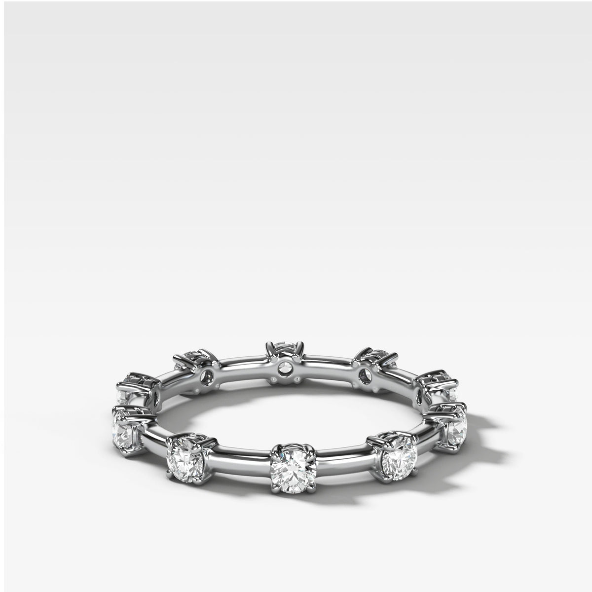Claw Diamond Band: Spaced Eternity Band in White Gold by Good Stone