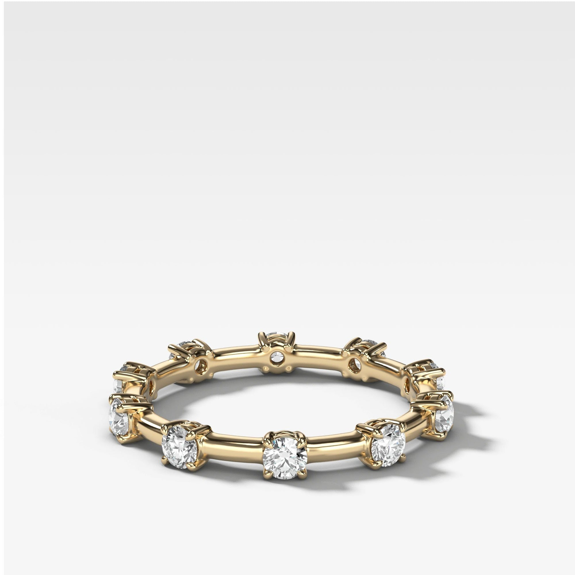 Claw Diamond Band: Spaced Eternity Band available in Yellow Gold by Good Stone