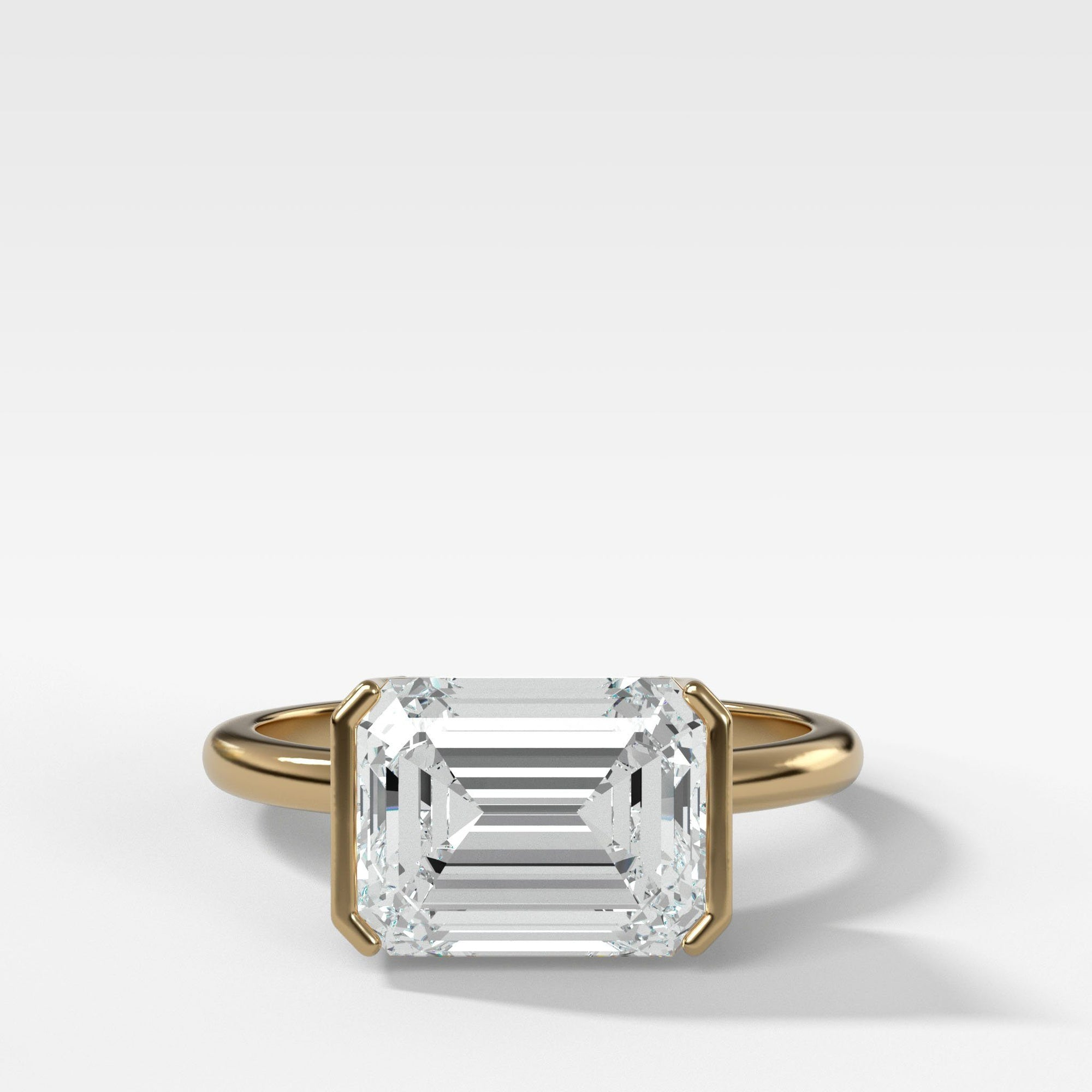 East West Half Bezel Solitaire Engagement Ring With Emerald Cut Engagement Good Stone Inc Yellow Gold 14k