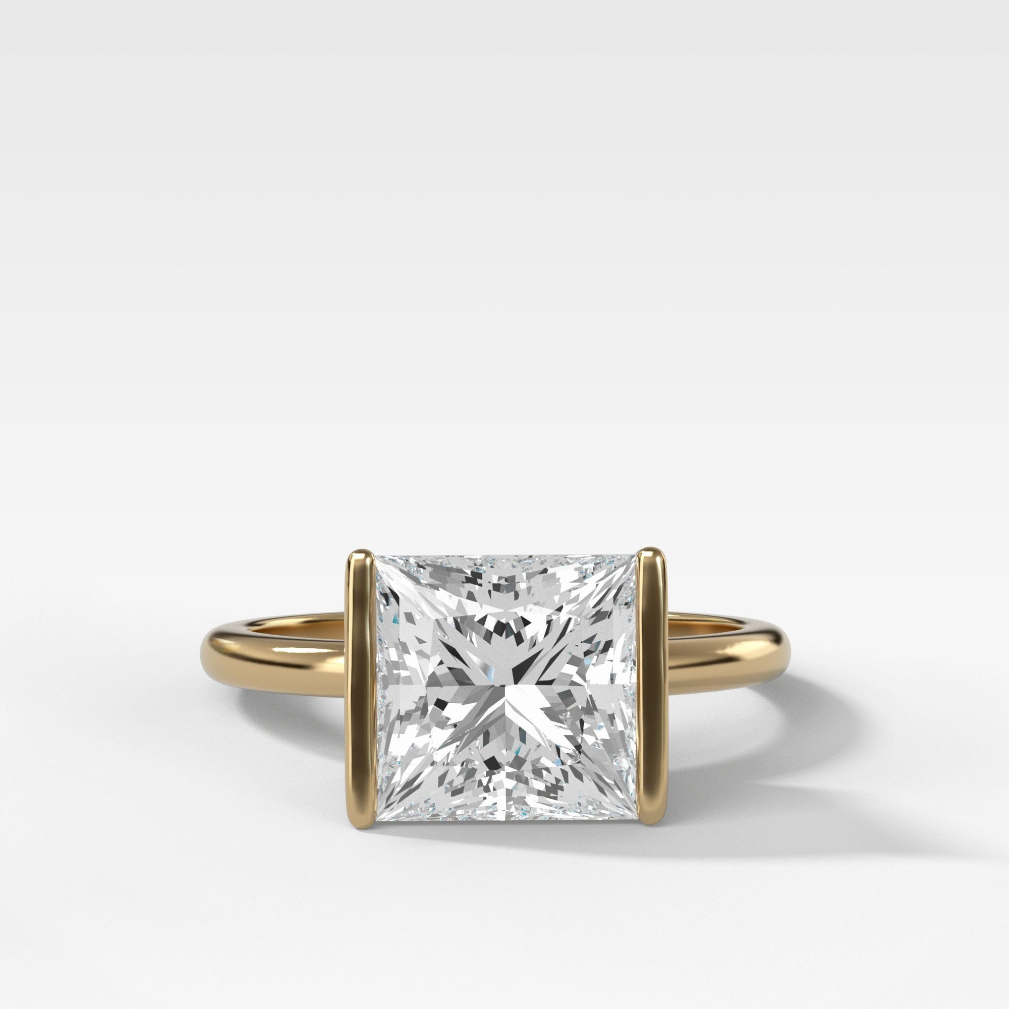 Half Bezel Solitaire Engagement Ring With Princess Cut in Yellow Gold by Good Stone