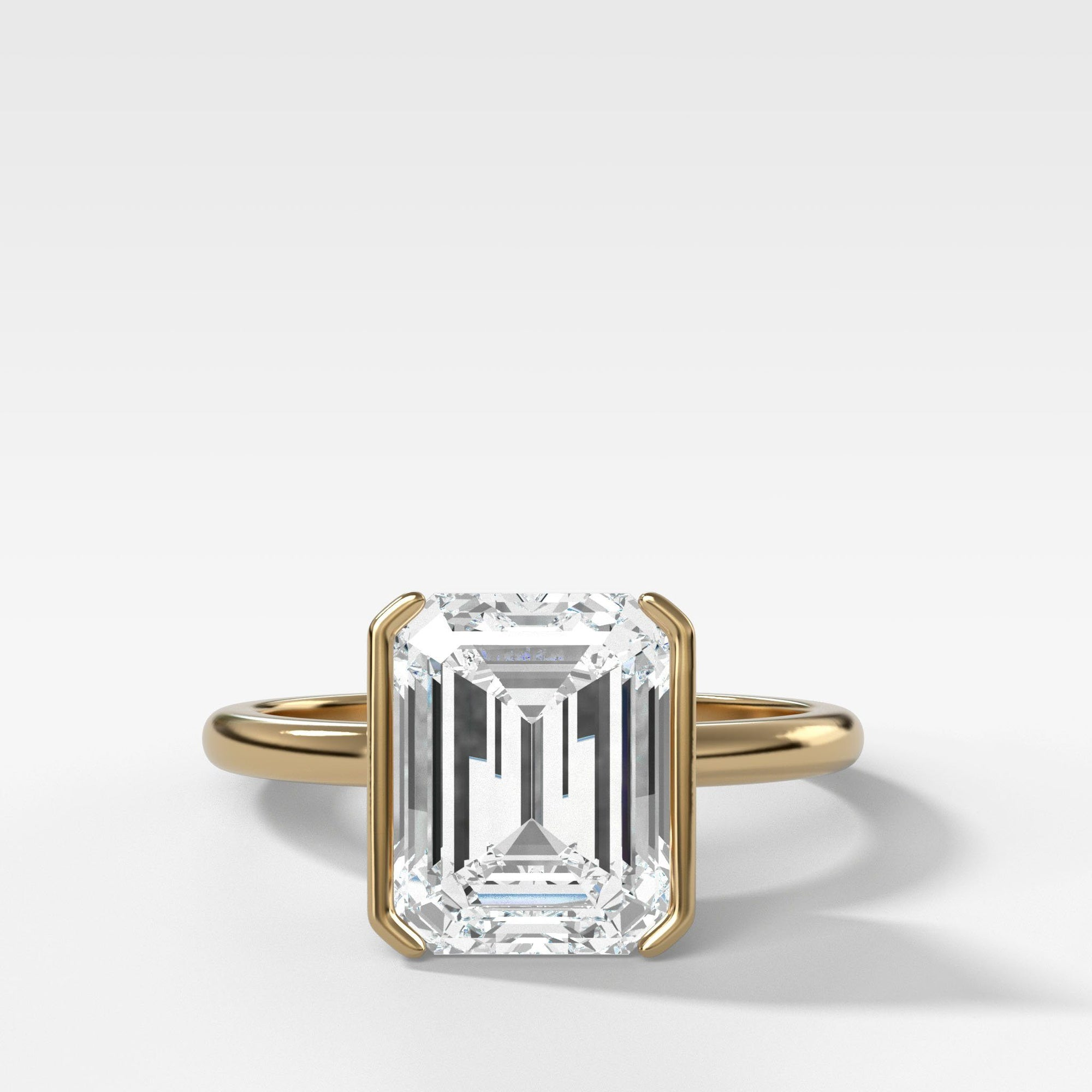North South Half Bezel Solitaire Engagement Ring With Emerald Cut in Yellow Gold by Good Stone