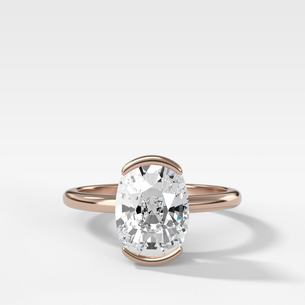 North South Half Bezel Solitaire Engagement Ring With Elongated Cushion Cut in Rose Gold by Good Stone