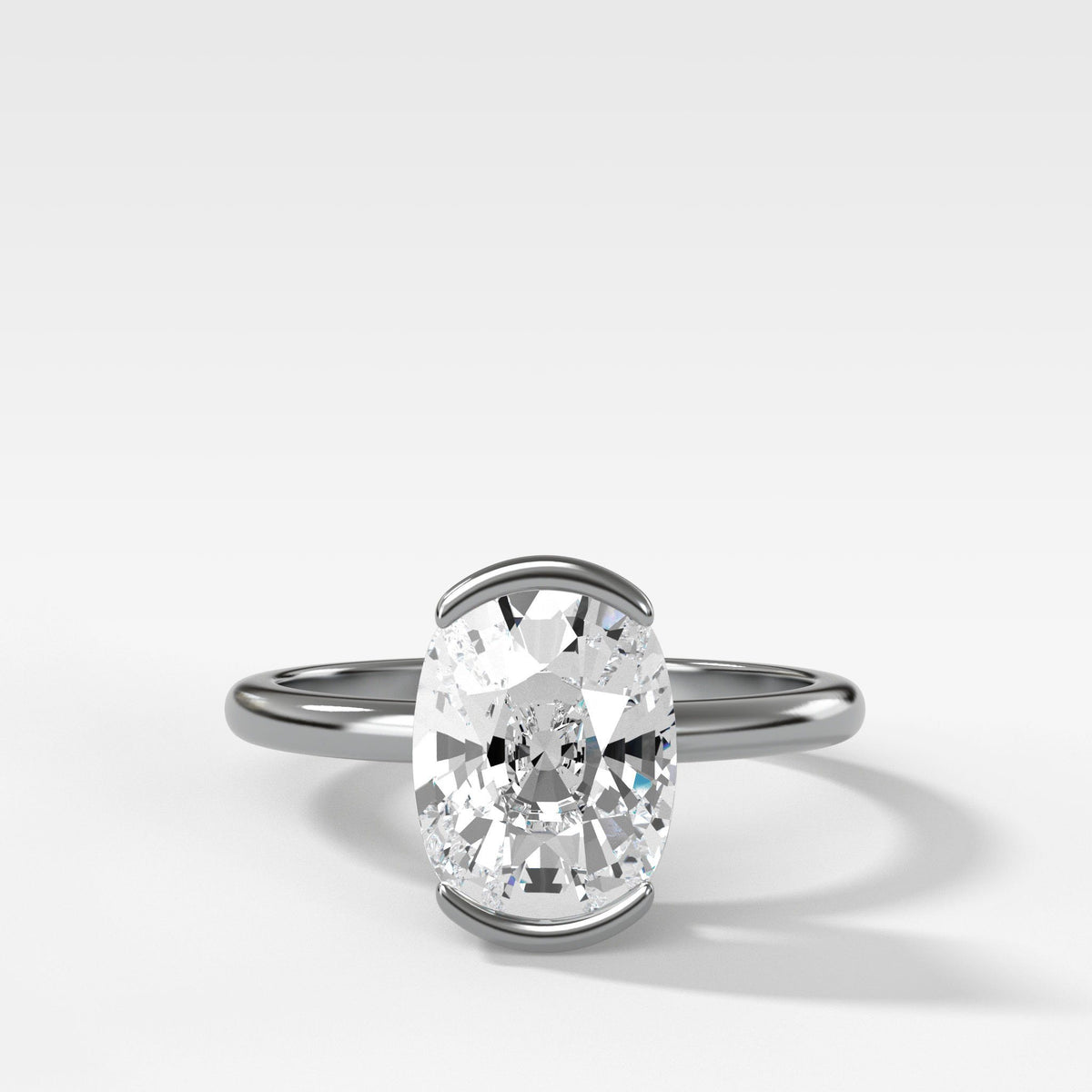 North South Half Bezel Solitaire Engagement Ring With Elongated Cushion Cut in White Gold by Good Stone
