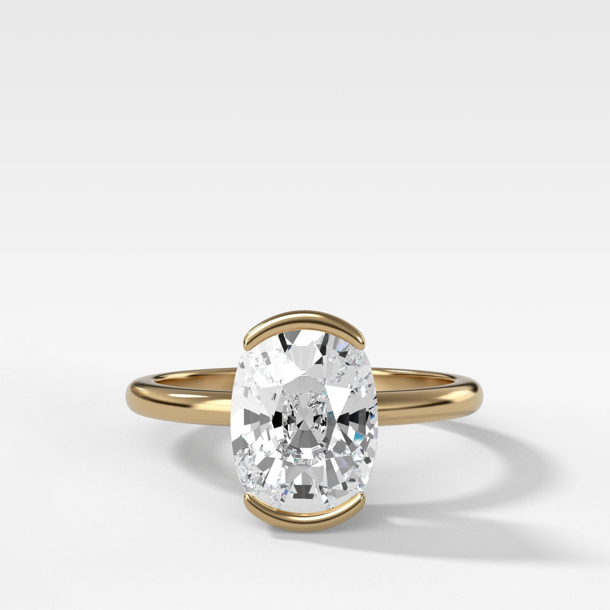 North South Half Bezel Solitaire Engagement Ring With Elongated Cushion Cut in Yellow Gold by Good Stone