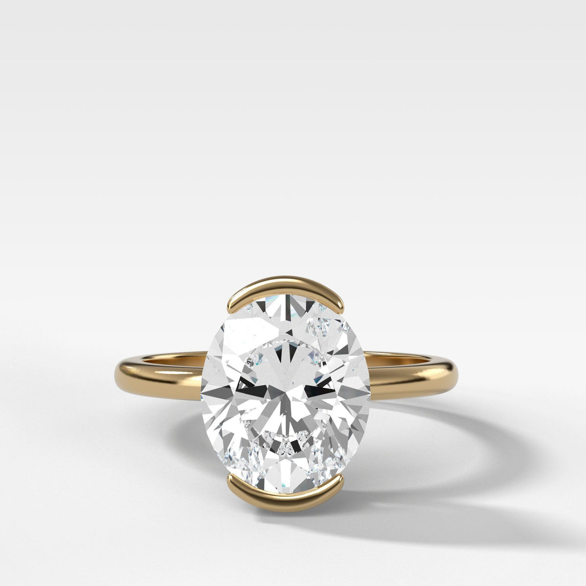 North South Half Bezel Solitaire Engagement Ring With Oval Cut In Yellow Gold By Good Stone