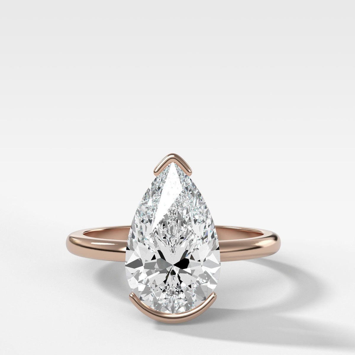 North South Half Bezel Solitaire Engagement Ring With Pear Cut in Rose Gold by Good Stone