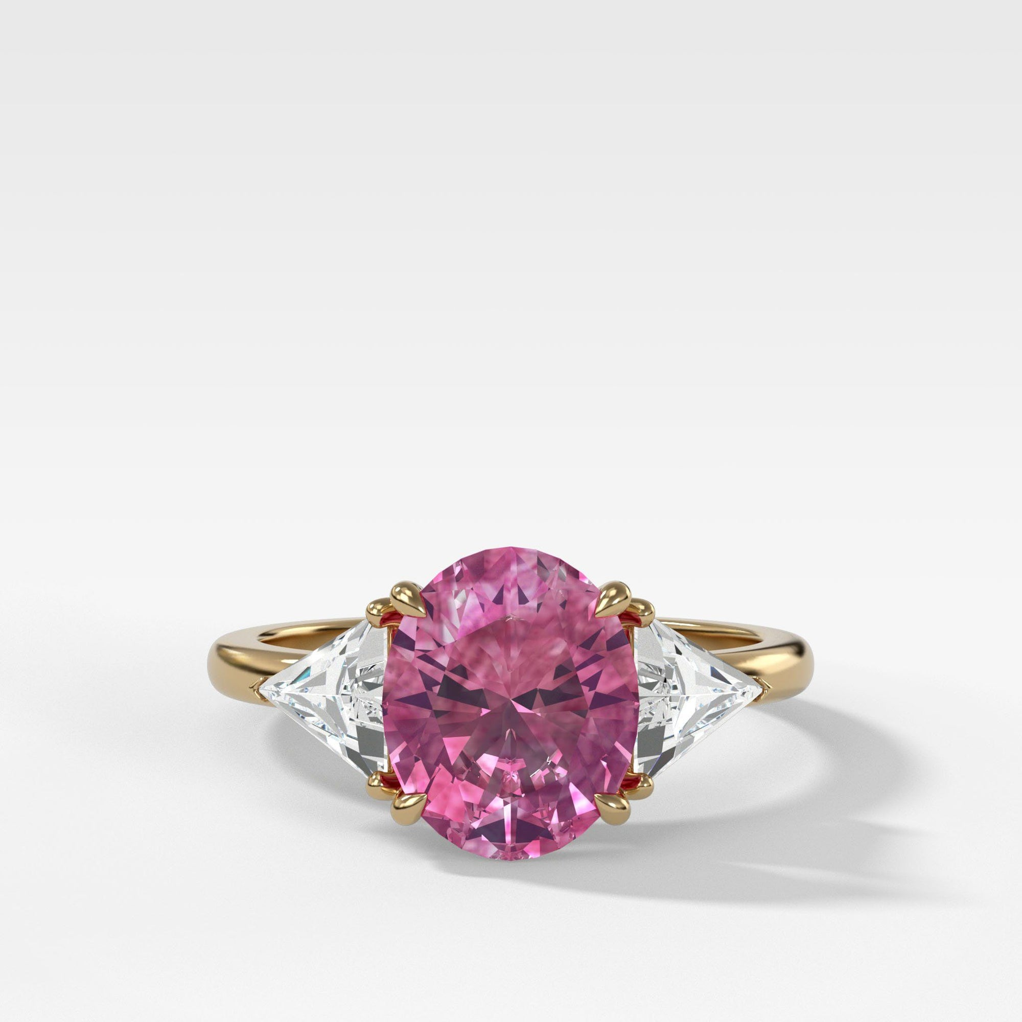 Pink Sapphire Three Stone Ring with Trillion Diamond Sides in Yellow Gold by Good Stone