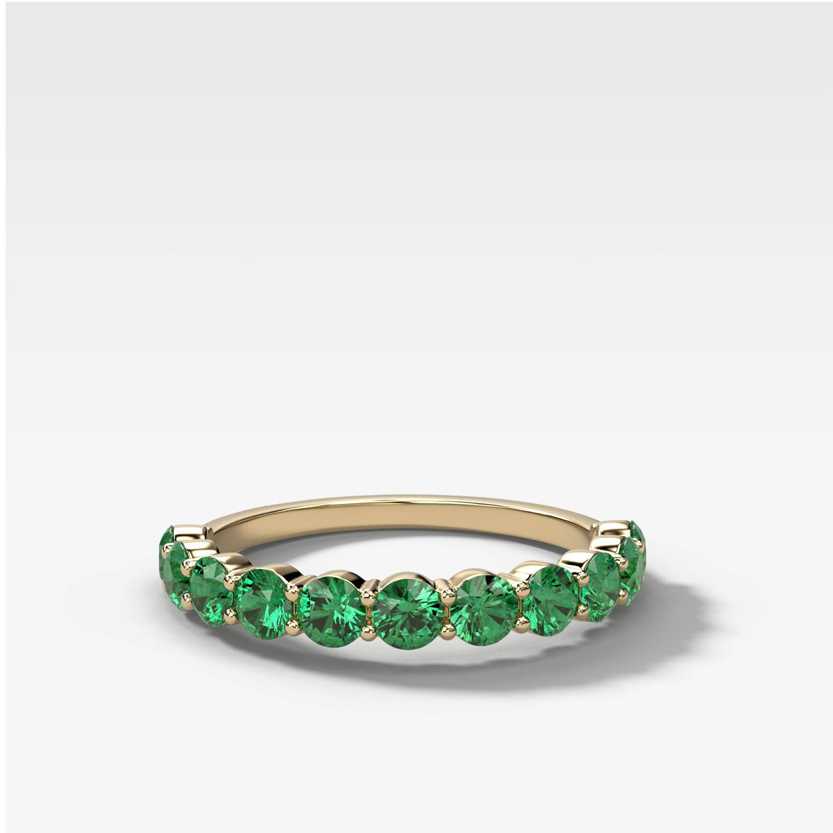 Shared Prong Stacker With Green Emeralds in Yellow Gold by Good Stone