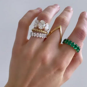 Green Emerald Oval Eternity Band available in Gold and Platinum by Good Stone