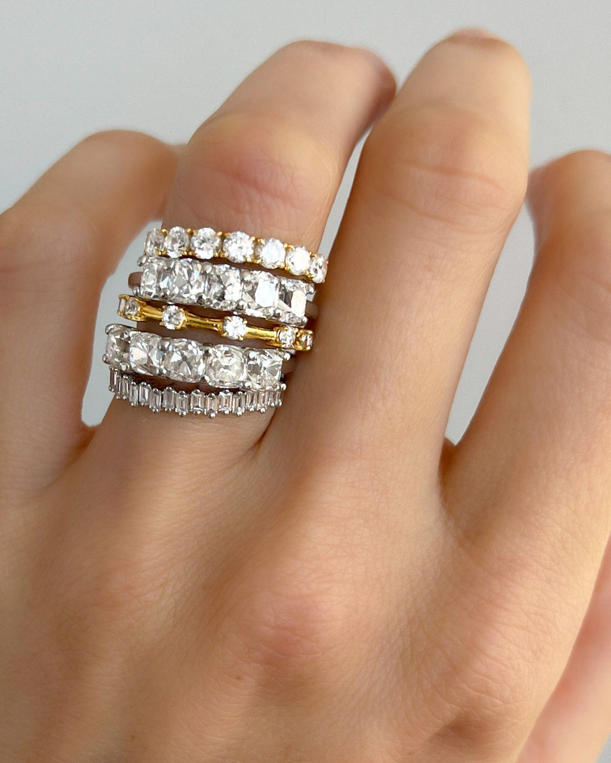 Claw Diamond Band: Spaced Eternity Band available in Gold and Platinum By Good Stone