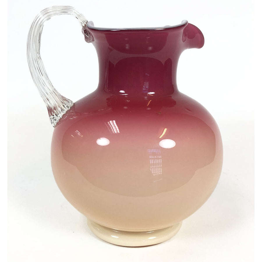 Vintage hand-blown glass pitcher with cased pink to peach gradient
