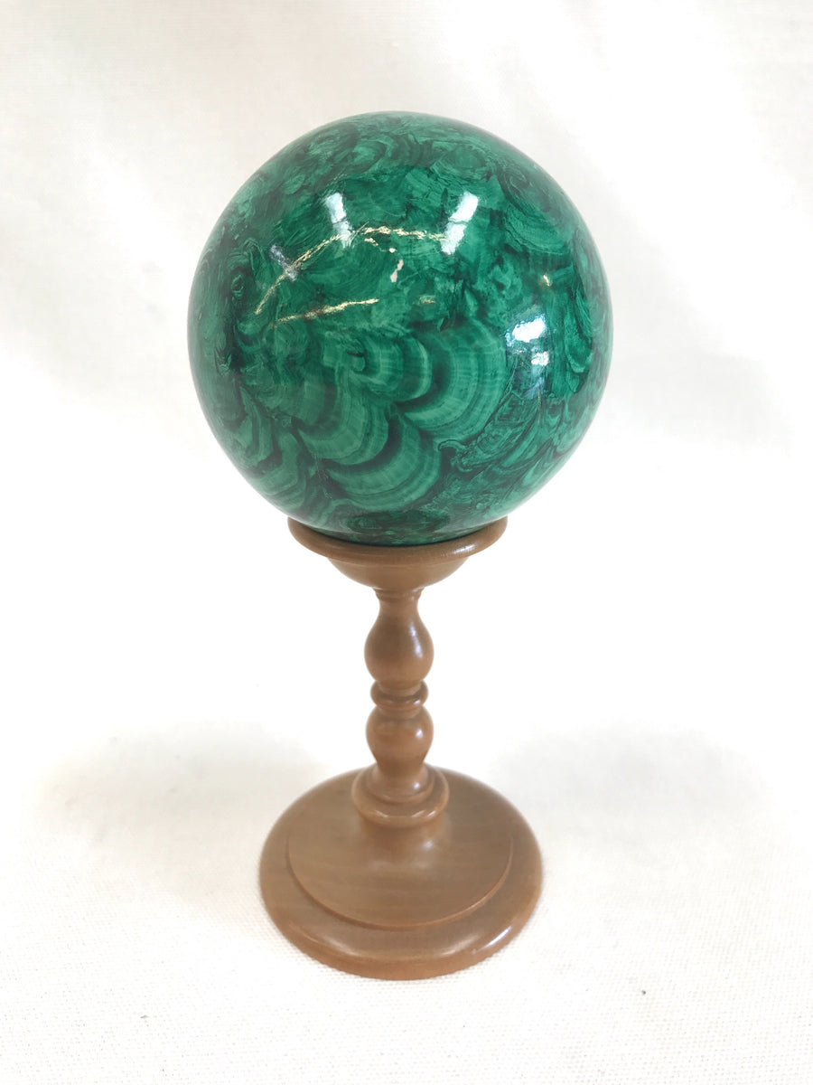 1970s faux malachite sphere on wood stand at The Mart Collective in Venice, CA