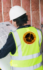 Worker with a yellow safety vest with a custom printed logo on the back