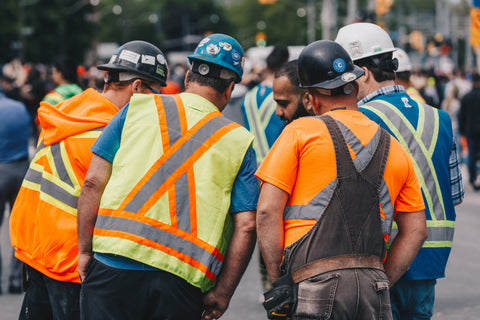 Construction workers with safety vest