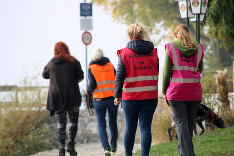 Group of women walking in a park with custom printed safety vest