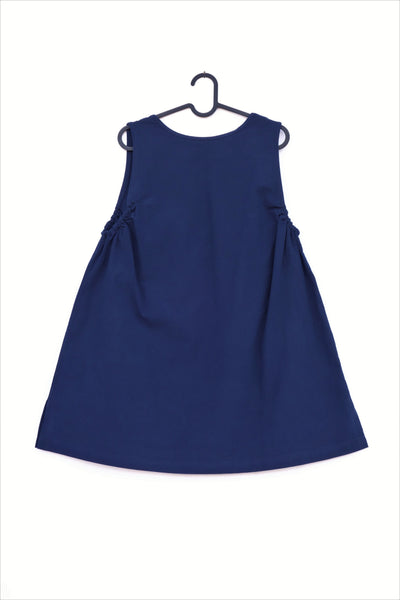 A cat-themed, cotton, dark-blue navy shirt/mini A-line dress/top/tunic on a hanger back view
