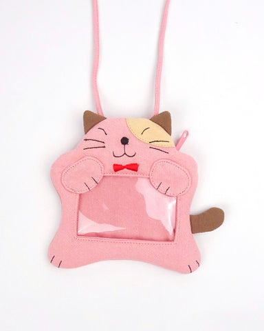 A pink cat ID card Badge holder with two paws holding the PVC window, a lanyard attached, and a zipper pocket in the back