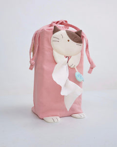 Cat tissue box cover in pink with drawstrings, two hanging straps, cat appliqué, fish charm, and cat feet, in front view.