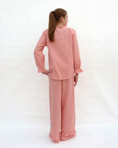 Tall women wearing pink pajamas with cat appliqué, embroidery details, and matching slippers in back view.