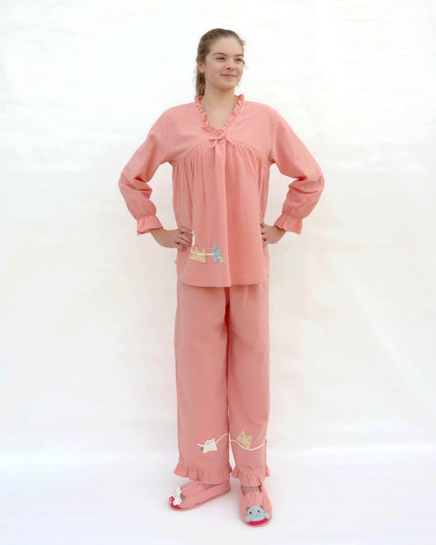 Tall women wearing pink pajamas with cat appliqué, embroidery details, and matching slippers in front view.