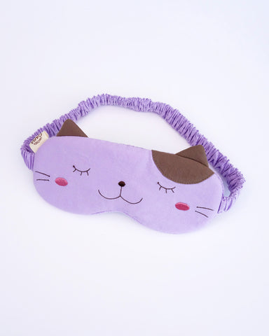 Cat eye mask in lilac color with appliqué, embroidery, 3D cat ears, elastic strap, foam-padding, in front view.