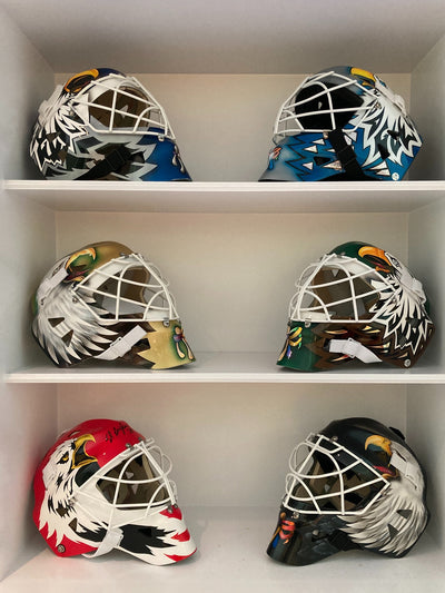 CLIENTS' COLLECTIONS: ED BELFOUR SIGNED GOALIE MASKS