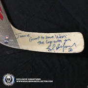 "ED BELFOUR GAME USED STICK SIGNED RBK REEBOK COMMEMORATING  ""THE 1999 STANLEY CUP CHAMPIONS DALLAS STARS"" -INSCRIPTION DEDICATED TO HIS TEAMMATE  JAMIE LANGENBRUNNER ""JAMIE GREAT TO HAVE WON THE CUP WITH YOU"""