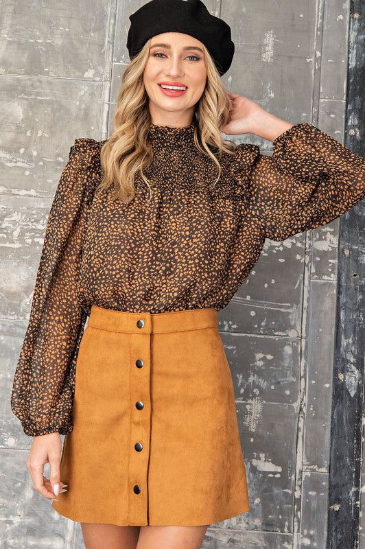 BLACK/RUST PRINTED BLOUSE WITH SMOCKED MOCK NECK