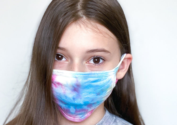 Tween girl in tie dye face mask