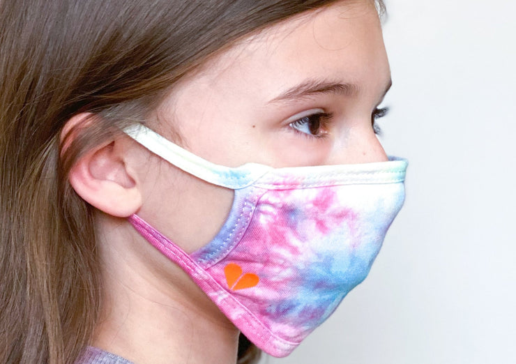side profile of tween girl in tie dye face mask