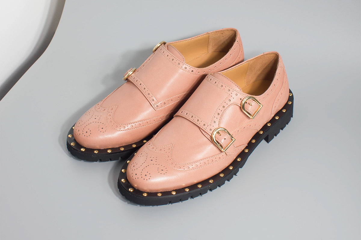 Pink double monk derby shoes with a rubber sole