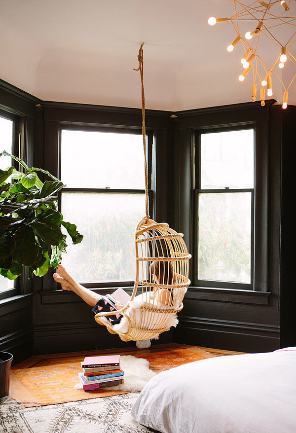 hanging indoor chair in designer bedroom