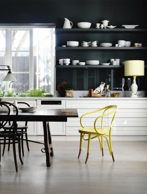 black_wall_kitchen_with_designer_chair