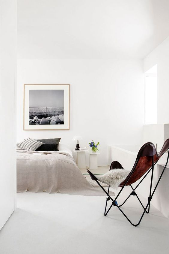 clean-modern-bedroom-with-designer-chair