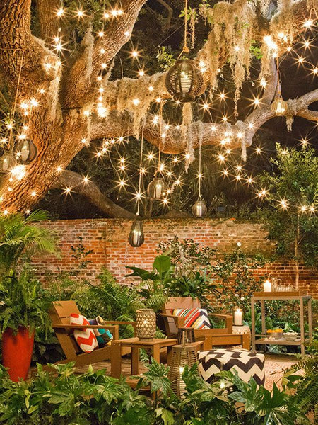outdoor furniture under fairy lights