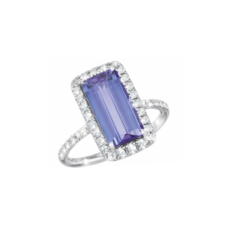 The Oliver Heemeyer 18k white gold Aquarius half circle diamond ring carries a rectangular tanzanite at its center and is framed by many sparkling diamonds.