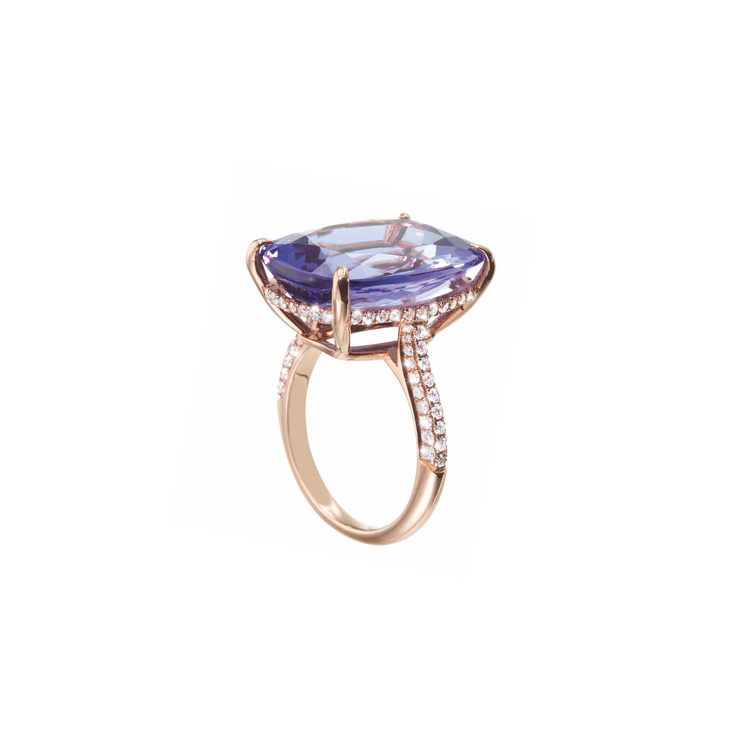 The Oliver Heemeyer Audra ring carries a purplish-blue tanzanite in its center, framed by diamonds. This stunning design is handcrafted of 18k rose gold and made for special moments.