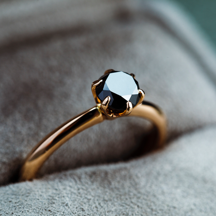 Black diamonds are always in style and make every piece of jewellery outstanding. This Oliver Heemeyer ring carries a beautiful black solitaire diamond, set in 18k rose gold and carefully handcrafted.