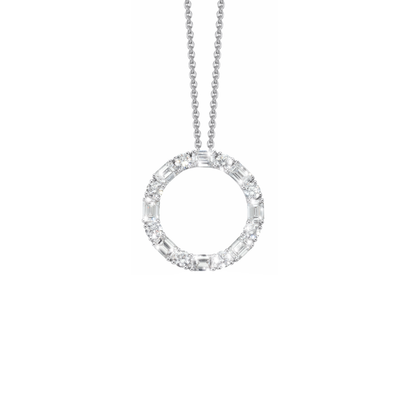 Radiance in its purest form, designed and made by Oliver Heemeyer. The pendant, a diamond set halo, is adorned with 16 diamonds and made of 18k white gold.