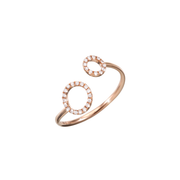 Oliver Heemeyer Circle of Life open diamond ring is made of 18k rose gold and crafted with 30 sparkling diamonds arranged in two circular shapes.