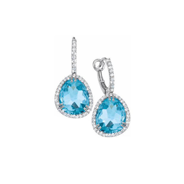 Oliver Heemeyer Cocktail diamond earrings carrying a colourful topaz in its center, framed with sparkling diamonds and made of 18k white gold. Stone colour: Swiss  blue