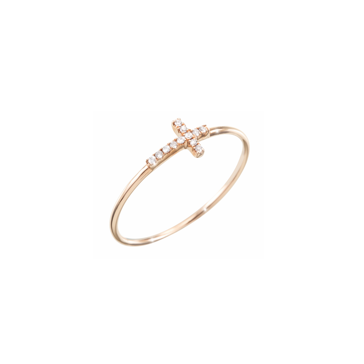 This cross ring is made of 18k rose gold and adorned with 12 sparkling diamonds.  Simplicity refined with diamonds, by Oliver Heemeyer.