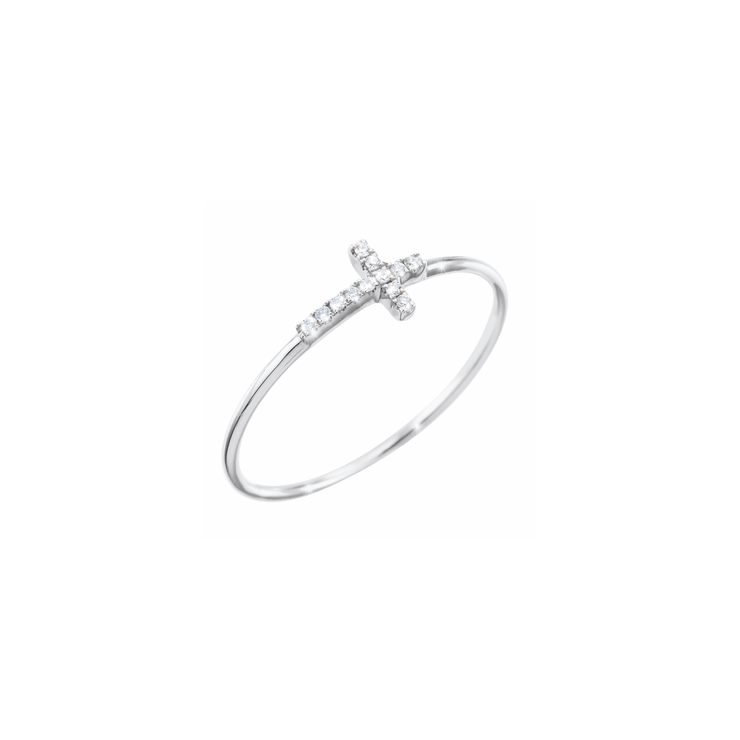 The cross ring is made of 18k white gold and adorned with 12 sparkling diamonds.  Simplicity refined with diamonds, by Oliver Heemeyer.