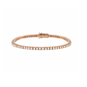 Carefully handcrafted, made of 18k rose gold and adorned with numerous sparkling diamonds. The diamond tennis bracelet is a  true jewellery icon and simply an all-time beauty.