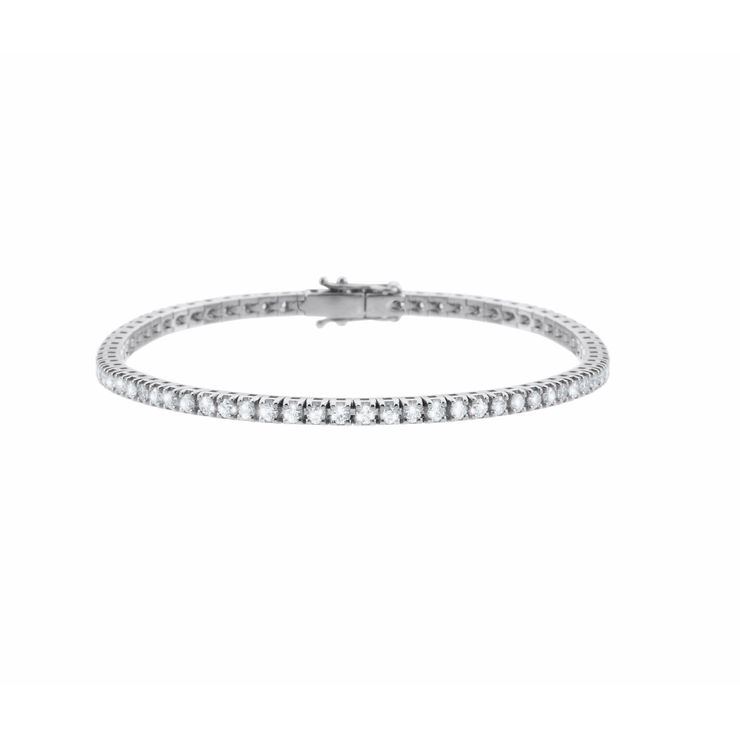 Carefully handcrafted, made of 18k white gold and adorned with numerous sparkling diamonds. The diamond tennis bracelet is a  true jewellery icon and simply an all-time beauty.