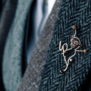Man wearing diamond monkey brooch from Oliver Heemeyer. Handcrafted, made of 18k rose gold and set with 126 diamonds.