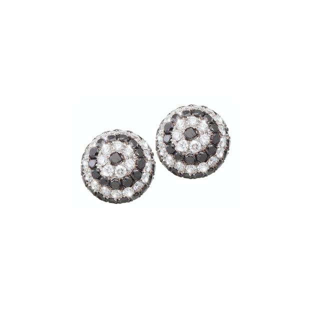 These fancy Oliver Heemeyer ear studs are designed in the shape of a dome. Adorned with black and white diamonds, set in 18k white gold, they become a contemporary eye catcher.