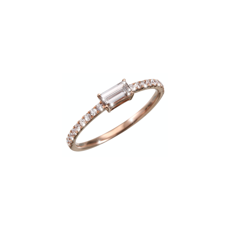 This elegant and delicate Oliver Heemeyer diamond ring features a baguette cut diamond in its center. Handcrafted and made of 18k rose gold it is adorned with many subtle sparkling diamonds.
