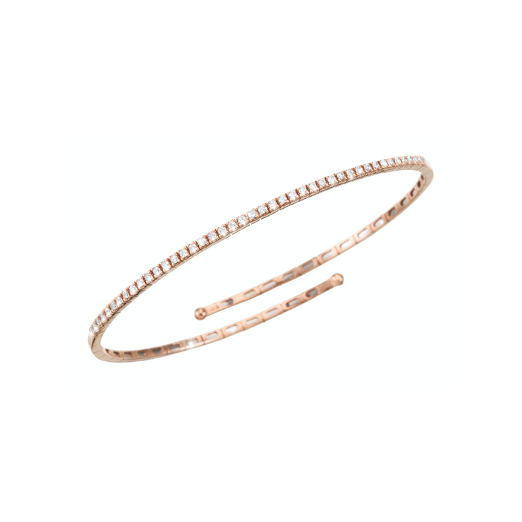 This beautiful and stylish design from Oliver Heemeyer adds a discreet sparkle to your outfit. Diamonds arranged in a line and handmade of 18k rose gold.