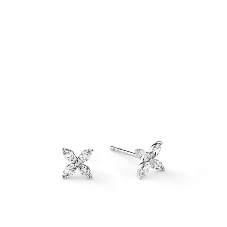 Delicate and sparkling. Diamonds arranged in a flower design and made of 18k white gold. The Marquise diamond ear studs from Oliver Heemeyer are a perfect every day choice.
